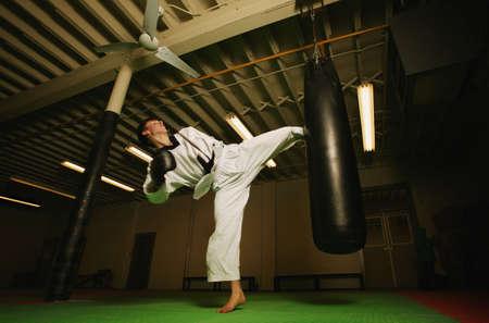 punching bag: A man practicing Martial Arts