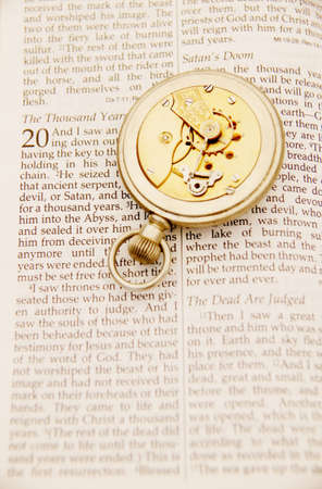 end times: Inside of pocket watch on the Bible
