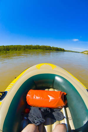 dingy: Rubber boat on water Stock Photo