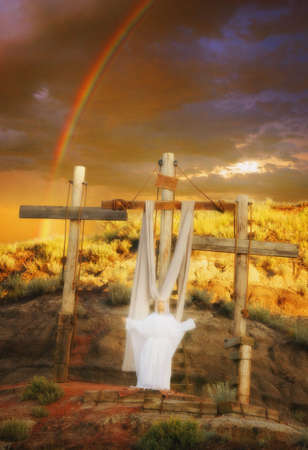 Angel at the crosses, rainbow in background Stock Photo