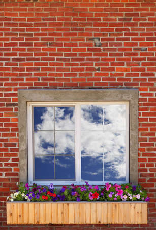 darren greenwood: A window with the cloudy sky reflecting in it