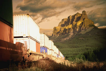 railway transportation: A train in the mountains Stock Photo