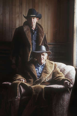 working cowboy: A father and son pair