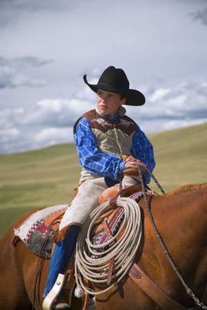 carson ganci: Young Cowboy on horse