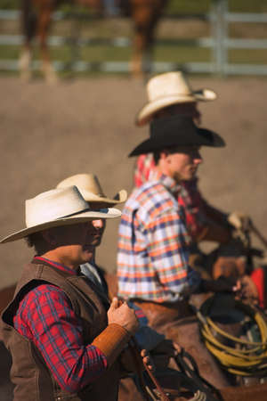 ranchers: Cowboys look on Stock Photo