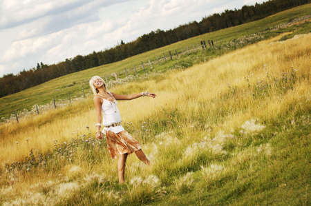 Teen girl walking through field photo