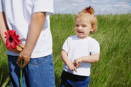 warkentin: Boy holds a flower behind his back Stock Photo