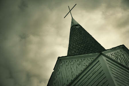 imaginor: A cross on a steeple of a church