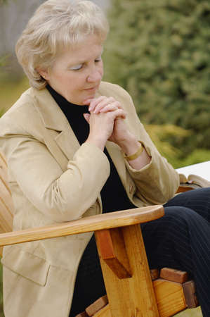 righteous: Woman prays Stock Photo