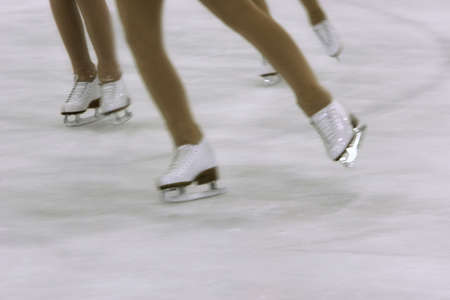 Girls with figure skates photo