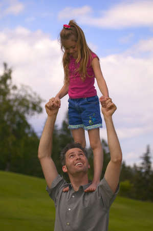 paternal: Father and daughter play together