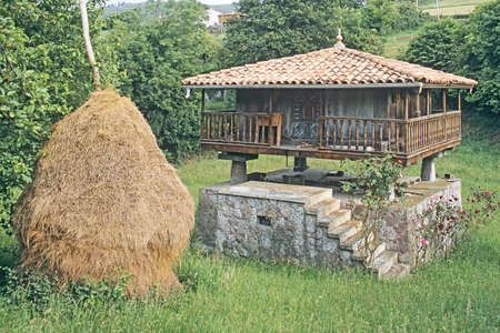 Traditional Stone Granary (Horreo) with Haystack in Asturias photo