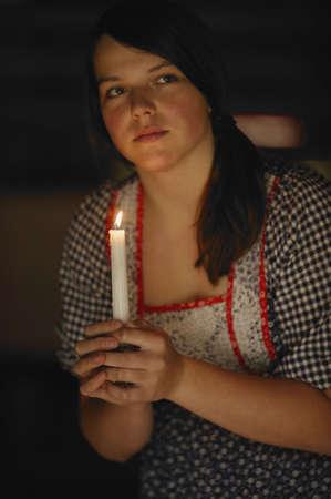 warkentin: Woman holding candle