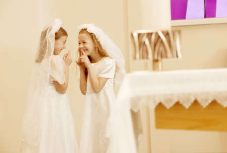 the first communion: Girls taking their first communion