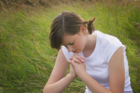 A teenager prays Stock Photo - 5642595