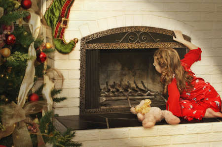 Girl checks for Santa Stock Photo