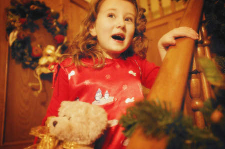 imaginor: Child comes down the stairs on Christmas morning Stock Photo