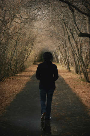 Woman walks down a pathway