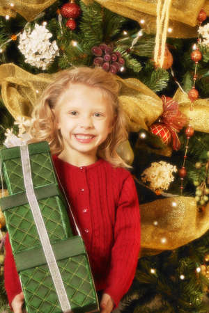 leah: Child with Christmas present Stock Photo