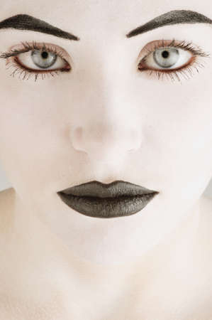fixate: A womans face in black and white Stock Photo