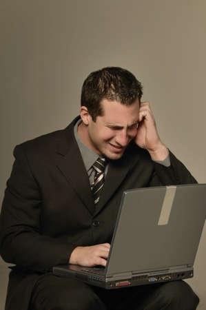 warkentin: Businessman with laptop computer Stock Photo