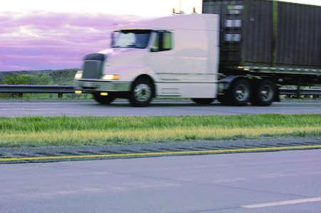 muz: A semi truck on a highway