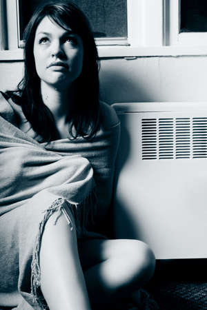 cold: Sitting by a heating vent Stock Photo