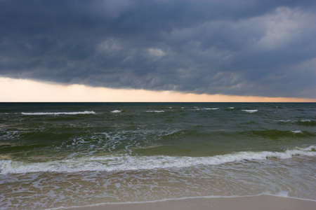 natural selection: Storm clouds over the surf Stock Photo