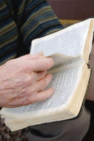 Senior reading Bible