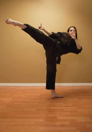 martial arts woman: A kick Stock Photo
