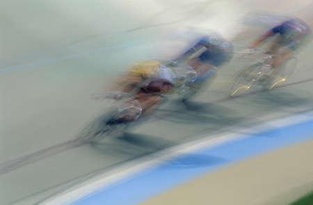 Cyclists racing on bike track photo