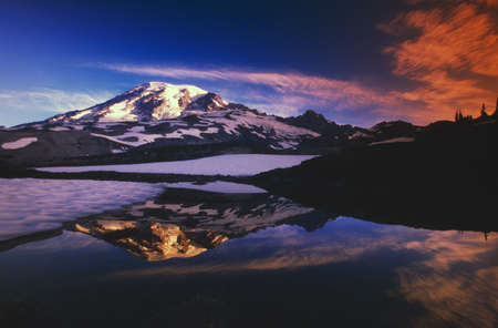 natural selection: Mount Rainier and reflection in pond at sunrise. Stock Photo