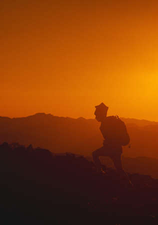 aneroid: Hiker silhouette, sunset on Aneroid Mountain, Eaglecap Wilderness Stock Photo
