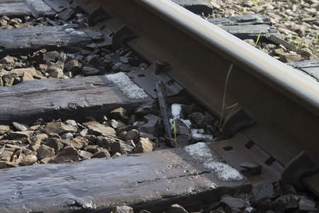 railway transportation: Close up of an older train track in the spring Stock Photo
