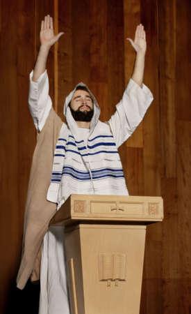 jew: Man praying at a pulpit