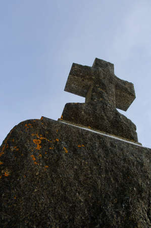 An aged cross tombstone