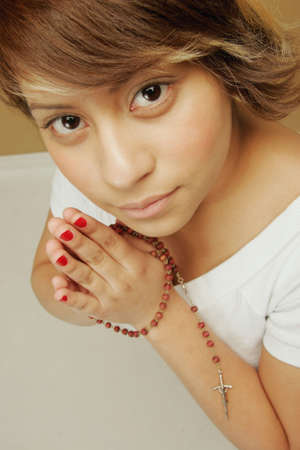 eyecontact: Young adult praying