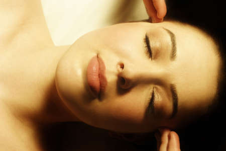 self indulgence: Woman having face massaged Stock Photo