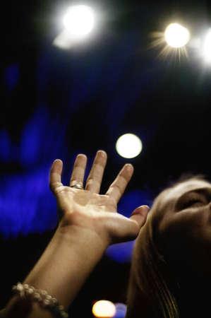 Woman praising God photo