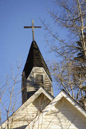 catholicism: Weathered cross on steeple of church Stock Photo