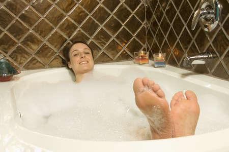 woman bath: Woman having a bubble bath