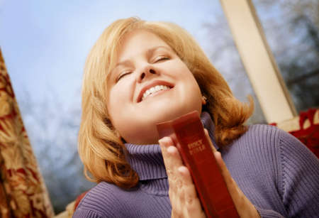 belief systems: Woman holding bible Stock Photo