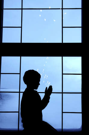 belief system: Child silhouette praying