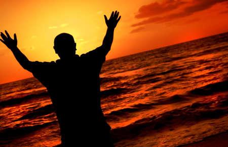 worshipping: Silhouette of worshipping man Stock Photo