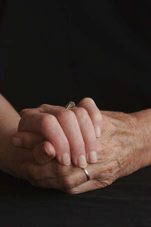 older person: Senior couple holding hands