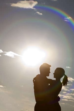couples hug: Silhouetted embrace