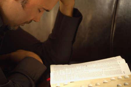 A man meditates on the word