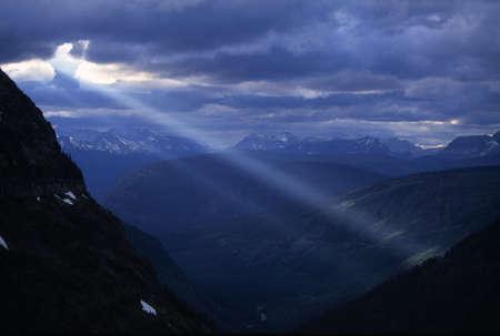 Sunbeams streaming through clouds