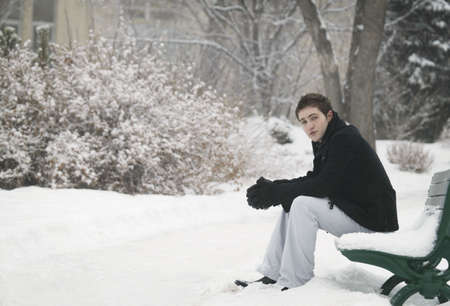 fixate: Sitting on a snowy bench Stock Photo