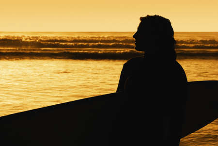 Silhouette of a surfer photo